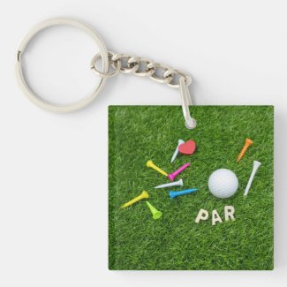Golf Par with golf ball and tees are on green Keychain