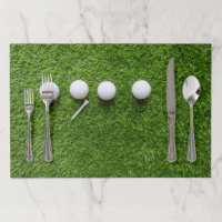 Golf place mat  golf balls and tee on green grass