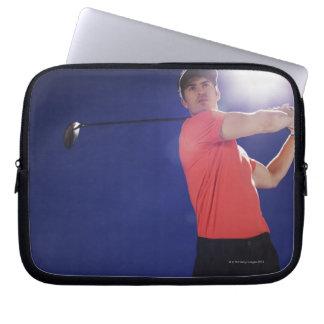 Golf player swinging club computer sleeve