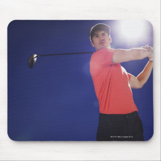 Golf player swinging club mouse pad