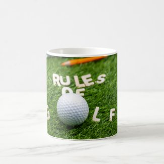 Golf rules of golf with golf ball and pencil ruler coffee mug