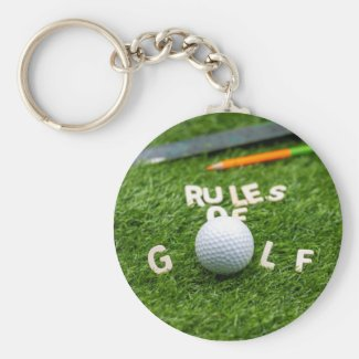 Golf rules of golf with golf ball and pencil ruler keychain