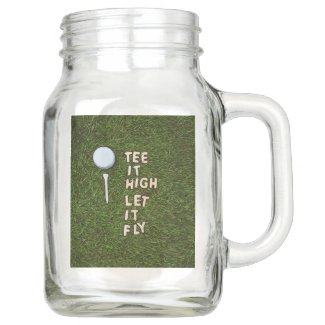 Golf tee it high let it fly on green grass mason jar