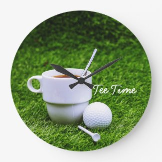 Golf tee time with cup of tea with golf ball large clock