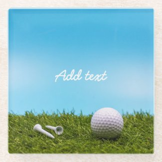 Golf tee time with golf ball and tee on green glass coaster