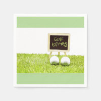Golf term on chalkboard on green grass with ball napkin
