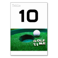 Golf time with golf ball next to hole table number