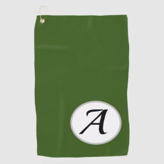 Golf towel on green background