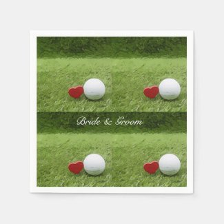 Golf wedding with golf ball and red heart on green napkins