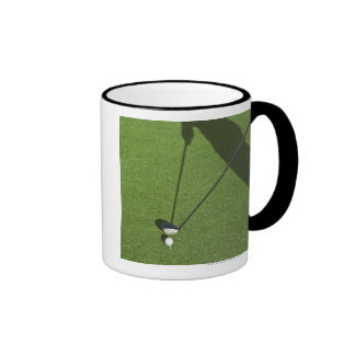 Golfer with driver prepares for swing ringer coffee mug