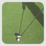 Golfer with driver prepares for swing square sticker