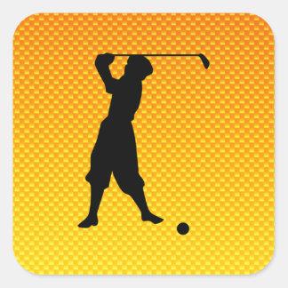 Golfista amarillo-naranja del vintage