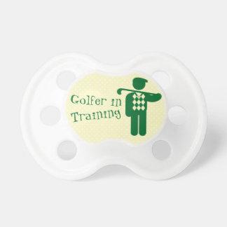 Golfista amarillo verde en pacificador del bebé de chupetes para bebés