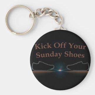 Golpee apagado sus zapatos de domingo con el pie llaveros