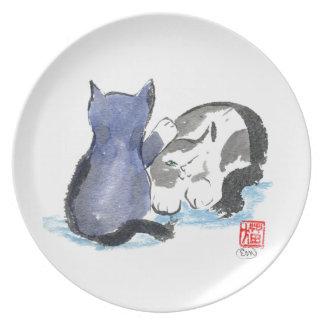Golpee ligeramente, golpee ligeramente, gatito del platos