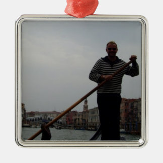 Gondalier On Grand Canal With Rialto Bridge Behind Metal Ornament