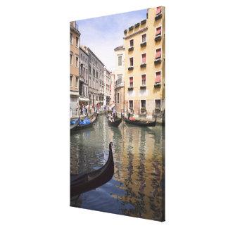 Gondolas in a canal, Venice, Italy Canvas Print