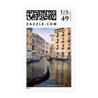 Gondolas in a canal, Venice, Italy Postage