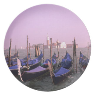 Gondolas ready for tourists in Venice Italy Plate
