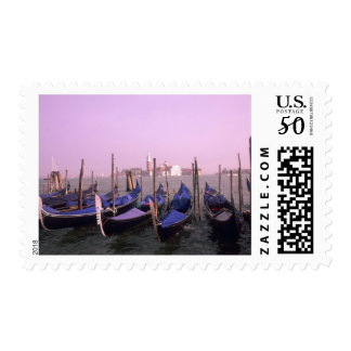 Gondolas ready for tourists in Venice Italy Postage
