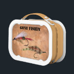"""GONE FISHIN&#39; LUNCH BOX<br><div class=""""desc"""">A couple of fishing flies on an earth tone background with text stating &quot;Gone Fishin&#39;&quot;.</div>"""
