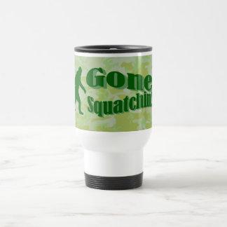 Gone Squatchin text on green camouflage Travel Mug
