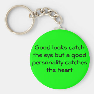 Good looks catch the eye but a good personality... basic round button keychain