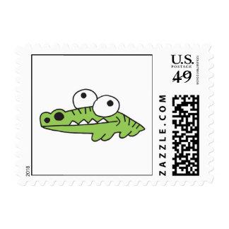 goofy baby alligator postage stamp