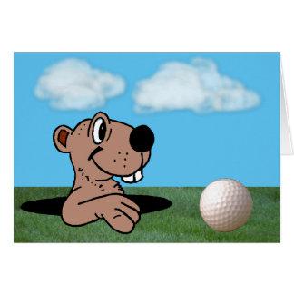 Gopher divertido y lindo y pelota de golf en tarjeta de felicitación