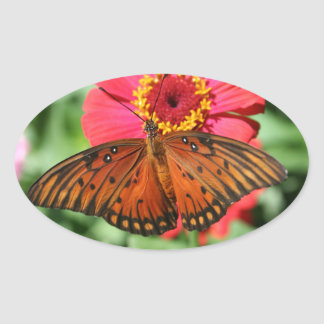 Gorgeous Butterfly on Red Zinnia Design. Oval Sticker