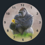 """Gorilla and Yellow Daisy Large Clock<br><div class=""""desc"""">A large gorilla sits in deep contemplation as he plucks at the petals of a yellow daisy or black-eyed susan flower. The sunlight shines against his back. This fantasy image is set against a muted background of browns and greens. Customize by adding your own caption, name or monogram to this...</div>"""