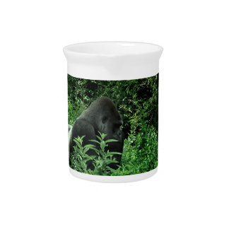 Gorilla in leaves green tint wildlife animal drink pitcher