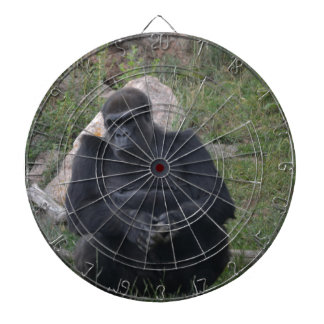 Gorilla sitting dartboard with darts