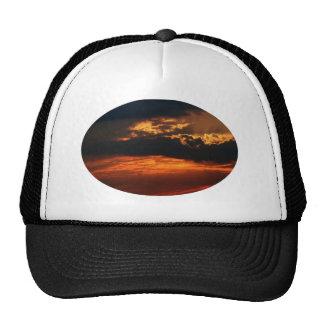 Gorra ardiente del óvalo de la puesta del sol