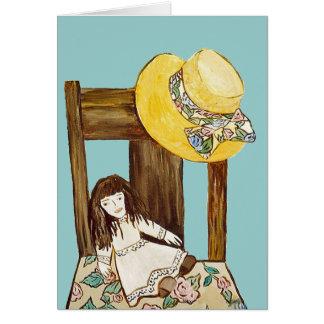 Gorra de paja, silla y tarjeta de nota interior de