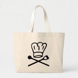 gorra del cocinero del cocinero con el icono de ma bolsas de mano
