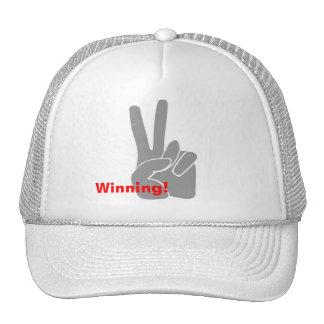 Gorra que gana de la muestra de la victoria