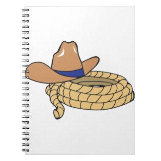 Gorra y cuerda de vaquero libros de apuntes