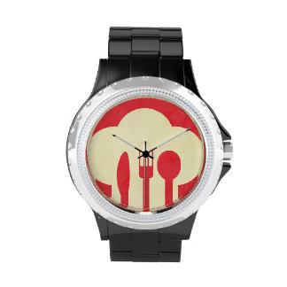 Gorra y utensilios del cocinero en rojo reloj