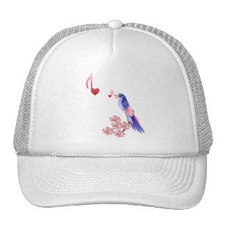 Gorras azules de las notas del pájaro y del amor
