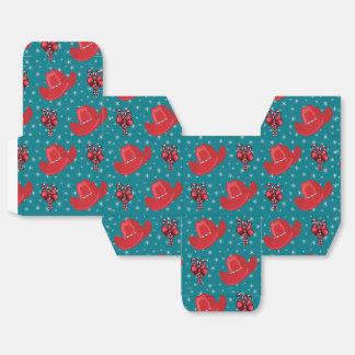 Gorras de vaquero del navidad y bastones de cajas para regalos