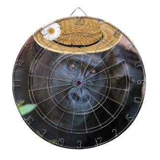 gorrilla in a straw hat dartboard with darts