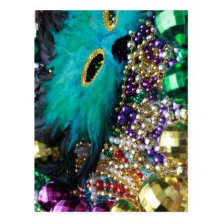 Gotas del carnaval y postal verde de la máscara de