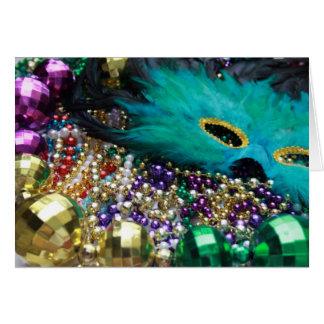 Gotas del carnaval y tarjeta verde de la máscara