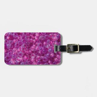 Gotas rosadas y de la lila de la semilla etiquetas maletas