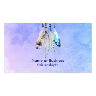 Gotas y plumas de la acuarela en un contexto tarjetas de visita