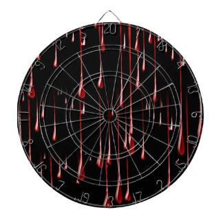 Goteos sangrientos en fondo negro tabla dardos