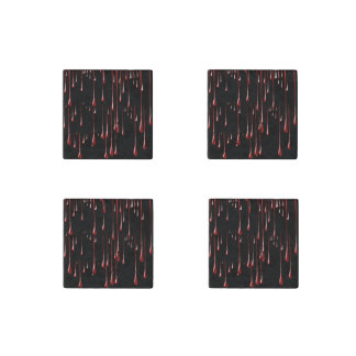 Goteos sangrientos en fondo negro imán de piedra