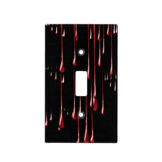 Goteos sangrientos en fondo negro tapa para interruptor