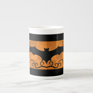 Gothic elegant bat with swirls black and orange tea cup